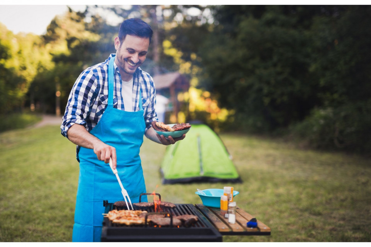 Man grilling different meats