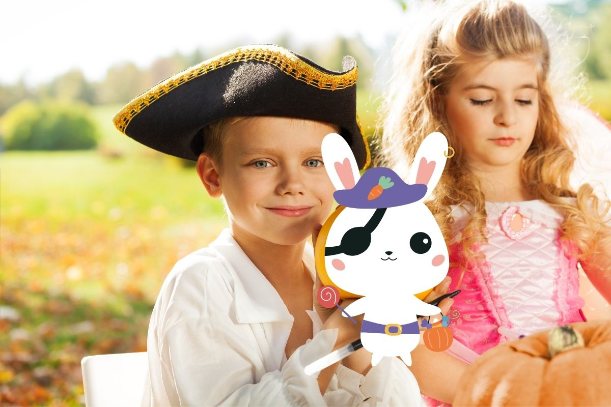 Boy in pirate hat and girl in princess dress