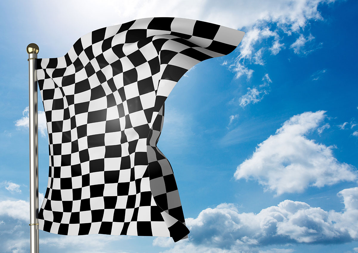 Checkered flag waving on a sunny day