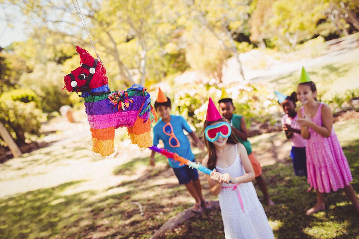 Children hitting a piñata